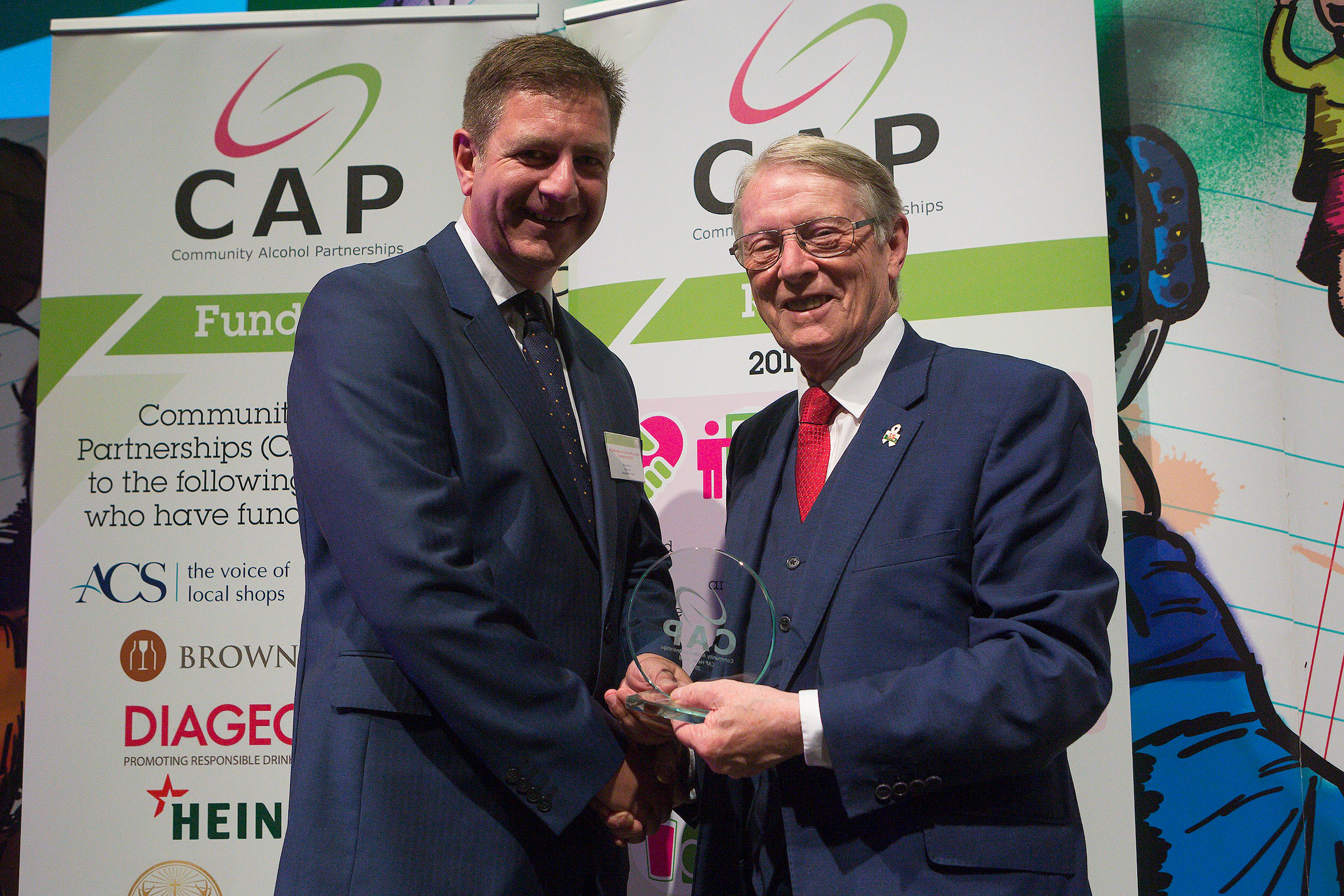 Inspector Andy Morrice of Lincolnshire Police receives the Community Alcohol Partnership CAP hero award from Alun Michael Police and Crime Commissioner for South Wales